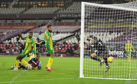 Stock Photo of Michail Antonio (2-L) of West Ham scores the 2-1 goal past Sam Johnstone (2-R) of West Bromwich during the English Premier League soccer match between West Ham United and West Bromwich Albion in London, Britain, 19 January 2021.