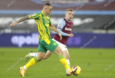 Jarrod Bowen (R) of West Ham in action against Kamil Grosicki (L) of West Bromwich during the English Premier League soccer match between West Ham United and West Bromwich Albion in London, Britain, 19 January 2021.