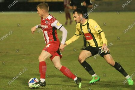 Jack Sparkes of Exeter takes on Harrogate s Jay Williams during the EFL Sky Bet League 2 match between Harrogate Town and Exeter City at the EnviroVent Stadium, Harrogate