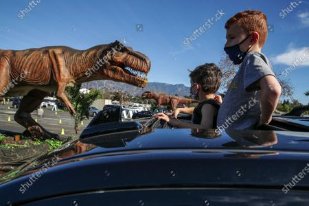 Editorial picture of Families with children drive through Jurassic Quest exhibits, Rose Bowl, Pasadena, California, United States - 16 Jan 2021
