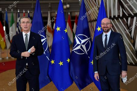 European Union Council president Charles Michel (R) welcomes NATO Secretary-General Jens Stoltenberg (L) before their meeting at the EU Headquarters in Brussels, Belgium, 19 January 2021.