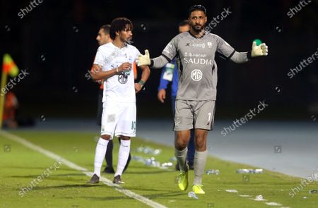 Al-Ahli's goalkeeper Yasser Al-Mosailem (R) gets ready to enter the pitch during the Saudi Professional League soccer match between Al-Ahli and Abha at King Abdullah Sport City Stadium, 30 kilometers north of Jeddah, Saudi Arabia, 19 January 2021.