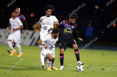Al-Ahli's players Yazeed Al Bakr (L-front) and  Salman Al-Muwashar (L-back) in action against Abha's Saad Bguir (R) during the Saudi Professional League soccer match between Al-Ahli and Abha at King Abdullah Sport City Stadium, 30 kilometers north of Jeddah, Saudi Arabia, 19 January 2021.