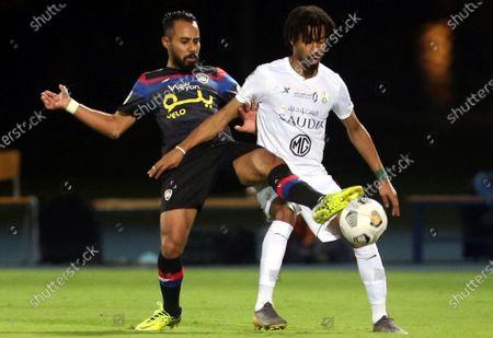 Al-Ahli's player Salman Al-Muwashar (R) in action against Abha's Sari Amro (L) during the Saudi Professional League soccer match between Al-Ahli and Abha at King Abdullah Sport City Stadium, 30 kilometers north of Jeddah, Saudi Arabia, 19 January 2021.