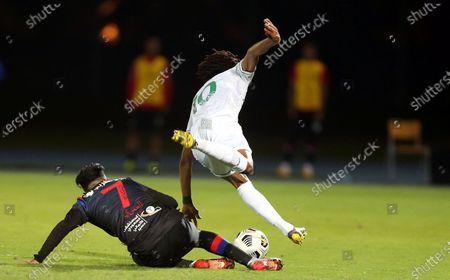 Al-Ahli's player Salman Al-Muwashar (R) in action against Abha's Saleh Al-Amri (L) during the Saudi Professional League soccer match between Al-Ahli and Abha at King Abdullah Sport City Stadium, 30 kilometers north of Jeddah, Saudi Arabia, 19 January 2021.