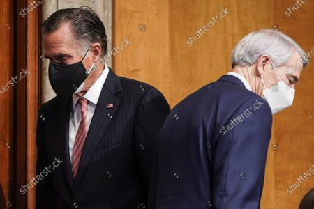 Senator Mitt Romney (R-UT) passes Senator Robert Portman (R-OH) as Alejandro Mayorkas, nominee to be Secretary of Homeland Security, testifies during a Senate Homeland Security and Governmental Affairs confirmation hearing on Capitol Hill in Washington, DC