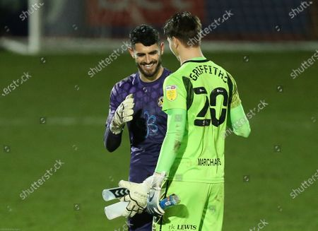Newport County goalkeeper Tom King speaks with his opposite number Cheltenham Town goalkeeper Josh Griffiths at the end of the match. King scored the opening goal of the match with a long range shot from his own area that beat Griffiths.