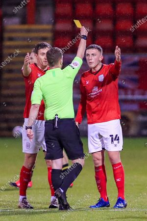 Crewe Alexandra midfielder Oliver Finney (14) receives a booking from The Referee Martin Coy during the EFL Sky Bet League 1 match between Crewe Alexandra and Bristol Rovers at Alexandra Stadium, Crewe