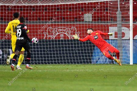 Dortmund's goalkeeper Roman Buerki fails to save a shot by Leverkusen's Florian Wirtz during the German Bundesliga soccer match between Bayer Leverkusen and Borussia Dortmund in Leverkusen, Germany