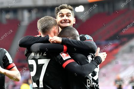 Leverkusen's Moussa Diaby, right, celebrates with Leverkusen's Lucas Alario and Leverkusen's Santiago Arias after scoring his side's first goal during the German Bundesliga soccer match between Bayer Leverkusen and Borussia Dortmund in Leverkusen, Germany