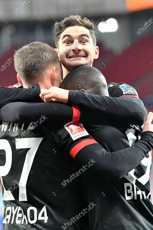 Stock Photo of Leverkusen's Moussa Diaby, right, celebrates with Leverkusen's Lucas Alario and Leverkusen's Santiago Arias after scoring his side's first goal during the German Bundesliga soccer match between Bayer Leverkusen and Borussia Dortmund in Leverkusen, Germany
