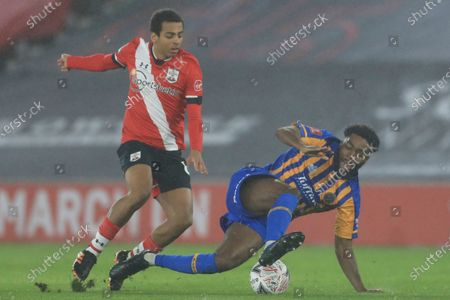 Southampton's Caleb Watts, left, fights for the ball with Shrewsbury's Ro-Shaun Williams during the FA Cup third round soccer match between Southampton and Shrewsbury at the St Mary's Stadium in Southampton, England