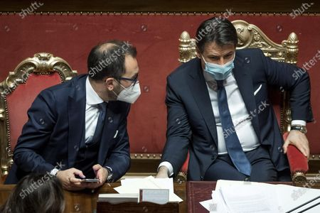 Italian Justice Minister Alfonso Bonafede (L) and Italian Prime Minister Giuseppe Conte during a debate in the Senate in Rome, Italy, 19 January 2021. Following the resignation of two ministers in Italian Prime Minister Conte's coalition government over a dispute on spending of EU funds during the pandemic, the Italian government is on the verge of another crisis.
