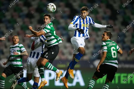 Sporting`s Gonçalo Inacio (L) fights for the ball with FC Porto`s Marko Grujic (C) during their Portuguese League Cup semi final soccer match held at Magalhaes Pessoa stadium, Leiria, Portugal, 19 January 2021.