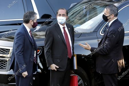 Alex Azar (C) departs from the West Wing of the White House in Washington after he resigned as head of Health and Human Services (HHS) Secretary on January 19, 2021.