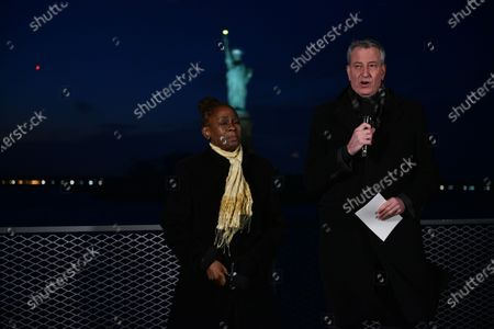 Chirlane McCray and Mayor Bill de Blasio deliver remarks near the Statue of Liberty for a national memorial to lives lost to COVID-19.