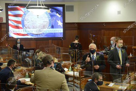 Rep. Steve Thompson, R-Fairbanks, gives a thumbs up to a fellow legislator as the Alaska House of Representatives convenes on in the Alaska State Capitol at Juneau, Alaska