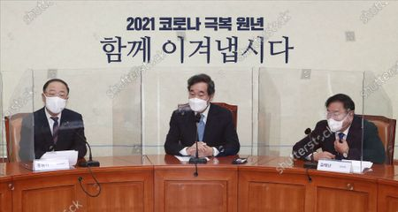 (L to R) Finance Minister Hong Nam-ki, Lee Nak-yon, leader of the ruling Democratic Party, and the party's floor leader Kim Tae-nyeon attend a ruling party-government meeting at the National Assembly in Seoul, South Korea, 20 January 2021.