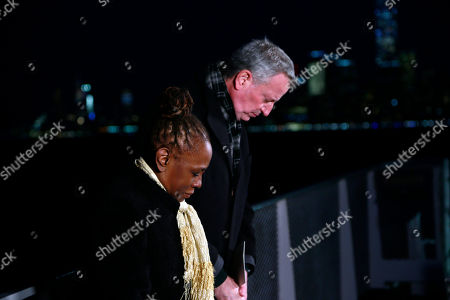 Stock Photo of New York City Mayor Bill de Blasio and New York City First Lady Chirlane McCray deliver remarks near the Statue of Liberty for a national memorial to lives lost to COVID-19. Remarks will take place on ferry near Battery Park