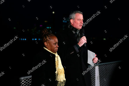 Stock Picture of New York City Mayor Bill de Blasio and New York City First Lady Chirlane McCray deliver remarks near the Statue of Liberty for a national memorial to lives lost to COVID-19. Remarks will take place on ferry near Battery Park