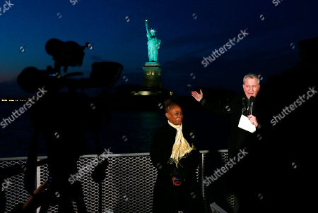 Stock Image of New York City Mayor Bill de Blasio and New York City First Lady Chirlane McCray deliver remarks near the Statue of Liberty for a national memorial to lives lost to COVID-19. Remarks will take place on ferry near Battery Park