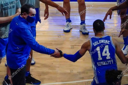 Duke head coach Mike Krzyzewski greets Jordan Goldwire (14) as he is introduced before an NCAA college basketball game against Pittsburgh, in Pittsburgh
