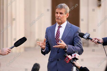 Tennessee Gov. Bill Lee speaks to reporters, in Nashville, Tenn