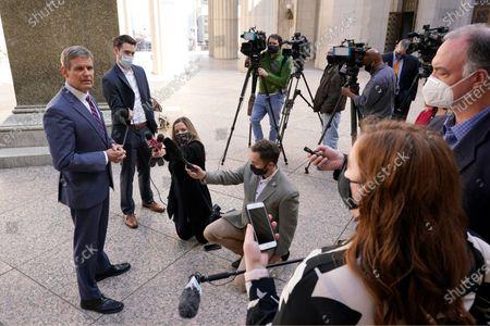 Tennessee Gov. Bill Lee, left, speaks to reporters, in Nashville, Tenn