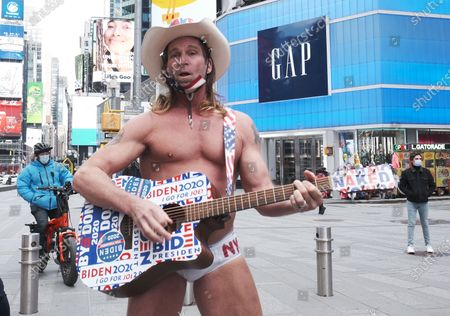 The Naked Cowboy stands in Times Square to celebrate the inauguration of Joe Biden as the 46th President of the United States.