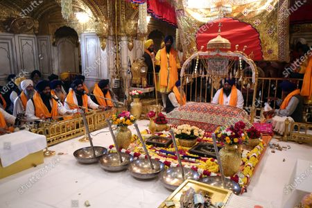 Stock Picture of Religious hymns are sung as the 'Jlau', or a show of Sikhism's symbolic invaluable items, is displayed around Sri Guru Granth Sahib Ji, the holy book of Sikh religion, inside The Golden Temple, the holiest of Sikh places on the occasion of the birth anniversary of the tenth Sikh Guru, Gobind Singh, in Amritsar, India, 20 January 2021. Guru Gobind Singh was the tenth and the last Sikh Guru who initiated the special order or sect of the Sikhs called the Khalsa Panth.