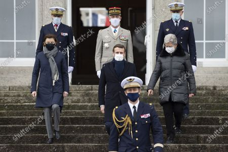 French President Emmanuel Macron (C) flanked by French Defence Minister Florence Parly (L), French Junior Minister of Remembrance and Veterans Affairs Genevieve Darrieussecq (R) and Special Chief of Staff of the President, French Vice-Admiral Jean-Philippe Rolland (up C) arrives for his presentation of New Year wishes to the military forces in Brest
