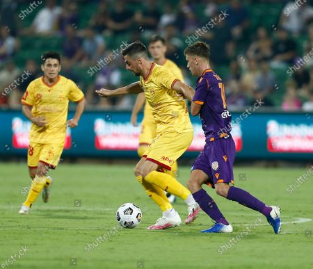 Tomi Juric from Adelaide United controls the ball in front of Callum Timmins of the Perth Glory; HBF Park, Perth, Western Australia, Australia; A League Football, Perth Glory versus Adelaide United.