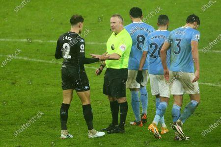 Matty Cash of Aston Villa remonstrates with referee Jon Moss