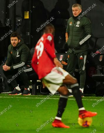 Head Coach-Ole Gunnar Solskjaer of Manchester United and Michael Carrick look towards Aaron Wan-Bissaka