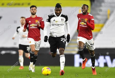 André-Frank Zambo Anguissa of Fulham chased by Aaron Wan-Bissaka of Manchester United