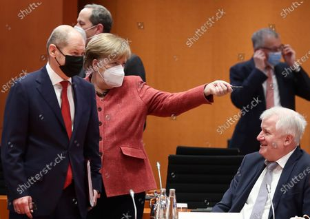 (L-R) German Minister of Finance Olaf Scholz, German Chancellor Angela Merkel and German Minister of Interior, Construction and Homeland Horst Seehofer during a cabinet meeting at the German chancellery in Berlin, Germany, 20 January 2021. The Federal Cabinet will discuss, among other things, the draft bill to amend the basic law to explicitly enshrine children's rights.
