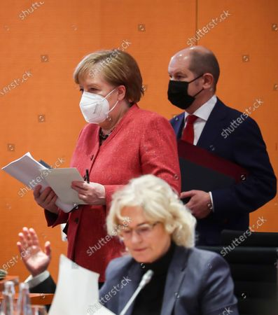 German Chancellor Angela Merkel (L) and German Minister of Finance Olaf Scholz (R) are seen behind of German Minister of Justice and Consumer Protection Christine Lambrecht (front) during a cabinet meeting at the German chancellery in Berlin, Germany, 20 January 2021. The Federal Cabinet will discuss, among other things, the draft bill to amend the basic law to explicitly enshrine children's rights.