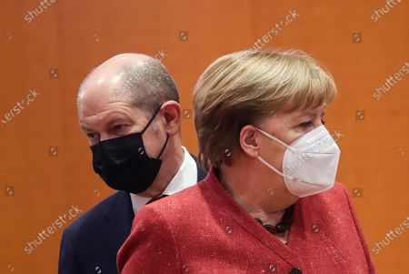 German Minister of Finance Olaf Scholz (L) and German Chancellor Angela Merkel (R) during a cabinet meeting at the German chancellery in Berlin, Germany, 20 January 2021. The Federal Cabinet will discuss, among other things, the draft bill to amend the basic law to explicitly enshrine children's rights.