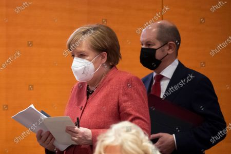 German Chancellor Angela Merkel (L) and German Minister of Finance Olaf Scholz (R) during a cabinet meeting at the German chancellery in Berlin, Germany, 20 January 2021. The Federal Cabinet will discuss, among other things, the draft bill to amend the basic law to explicitly enshrine children's rights.