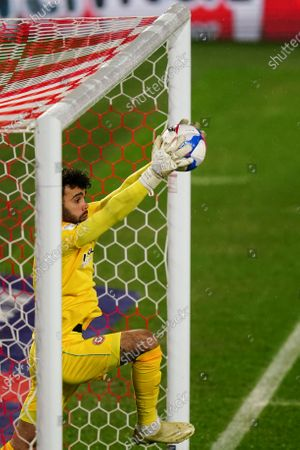 Stock Picture of Goalkeeper David Raya of Brentford catches the ball just in front of the goal-line from a header by Luke Berry of Luton Town