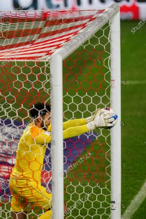 Goalkeeper David Raya of Brentford catches the ball just in front of the goal-line from a header by Luke Berry of Luton Town
