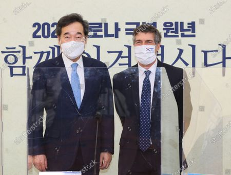 Lee Nak-yon (L), chief of the ruling Democratic Party, poses for a photo with new Israeli Ambassador to South Korea Akiva Tor during their meeting at the National Assembly in Seoul, South Korea, 20 January 2021. SOUTH KOREA OUT