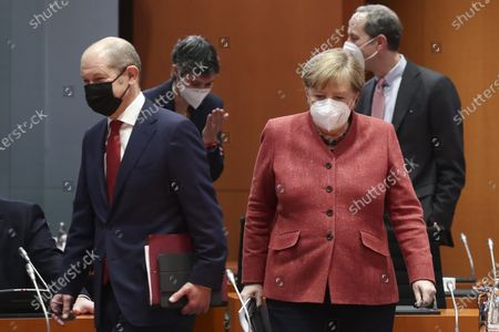 Stock Photo of German Minister of Finance Olaf Scholz (L) and German Chancellor Angela Merkel (R) during a cabinet meeting at the German chancellery in Berlin, Germany, 20 January 2021.