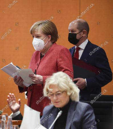 German Chancellor Angela Merkel (L) and German Minister of Finance Olaf Scholz (R) are seen behind of German Minister of Justice and Consumer Protection Christine Lambrecht (front) during a cabinet meeting at the German chancellery in Berlin, Germany, 20 January 2021.