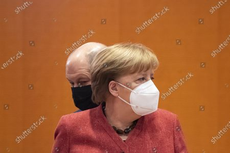 Stock Picture of German Minister of Finance Olaf Scholz (L) and German Chancellor Angela Merkel (R) during a cabinet meeting at the German chancellery in Berlin, Germany, 20 January 2021.