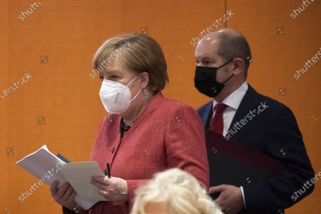 Stock Image of German Chancellor Angela Merkel (L) and German Minister of Finance Olaf Scholz (R) during a cabinet meeting at the German chancellery in Berlin, Germany, 20 January 2021.