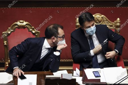 Stock Image of Giuseppe Conte, Italy's prime minister, right, speaks with Alfonso Bonafede, Italy's justice minister, during a debate in the Senate in Rome, Prime Minister Giuseppe Conte waged a charm offensive Tuesday in the Italian Senate ahead of a vote that will decide whether his coalition can survive