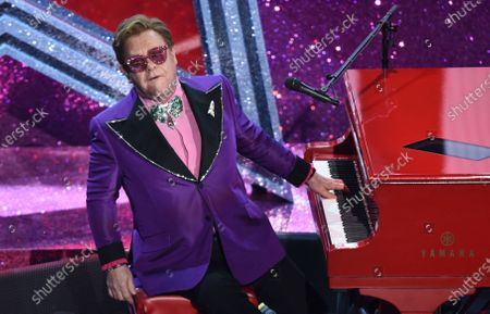 "Elton John performs ""(I'm Gonna) Love Me Again"" nominated for the award for best original song from ""Rocketman"" at the Oscars, at the Dolby Theatre in Los Angeles. Dozens of U.K. music stars including Elton John, Ed Sheeran and conductor Simon Rattle on Wednesday Jan. 20, 2021, say musicians have been ""shamefully failed"" by the British government, which has left them facing post-Brexit restrictions on touring in the European Union"