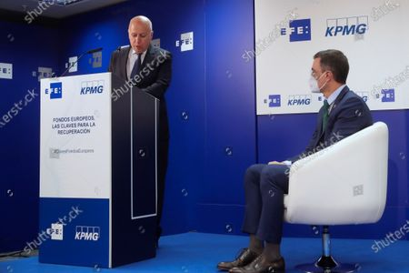 Spanish Prime Minister Pedro Sanchez (R) listens to the speech of chairman of KPMG in Spain Hilario Albarracin (L) during the Forum 'European Funds. The Clues for Recovery' organized by Efe and KPMG International at the headquarters of Efe News Agency in Madrid, Spain, 20 January 2021.