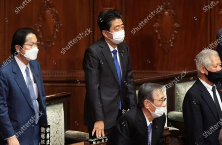 Former Japanese Prime Minister Shinzo Abe (C) attends Lower House's plenary session at the National Diet in Tokyo on Wednesday, January 20, 2021. Ruling and opposition parties questioned to Prime Minister Yoshihide Suga as Suga delivered his policy speech at the beginning of an ordinary Diet session on January 18.